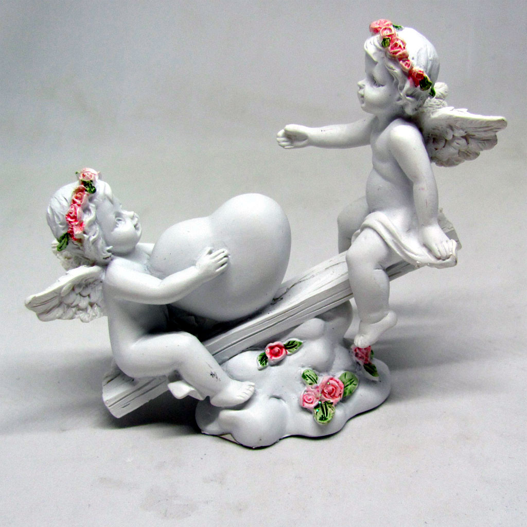 Angels with Pink Garland On See Saw