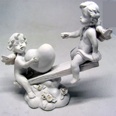 White Resin Angels On See Saw